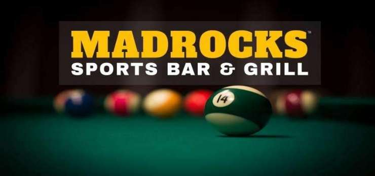 Illustrated here is an image of pool tables and balls at a Derby KS restaurant and lounge | Madrocks Sports Bar and Grill